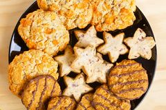 Variety of cookies on black plate Stock Images