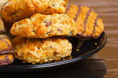 Variety of cookies on black plate Royalty Free Stock Photo