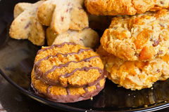 Variety of cookies on black plate Royalty Free Stock Photos