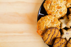 Variety of cookies on black plate.  Empty space Stock Photo