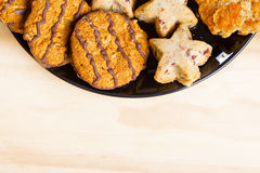 Variety of cookies on black plate.  Empty space Royalty Free Stock Photos