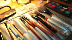 Variety of cosmetics, shadows, lipsticks, tassels in the workplace makeup artist stock video