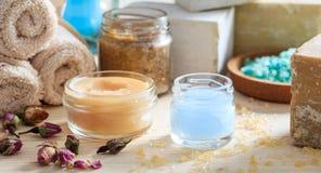 Variety of creams and bath salt - spa concept. Variety of creams and bath salt on wooden background Stock Image