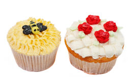 Variety of cupcakes with decorative techniques. Variety of vanilla cupcakes with various decorations on white background Royalty Free Stock Photography