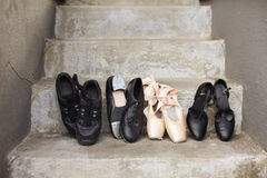 Variety of Dance Shoes. Closeup of a pair of jazz shoes, tap shoes, ballet pointe shoes, and character shoes representing a variety of dance classes in one image Royalty Free Stock Photography