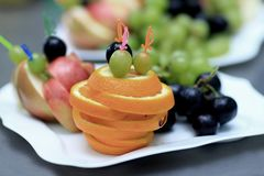 Cutting fruit on a plate in a restaurant stock images