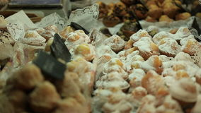 Variety delicious sweet food in the showcase in a  medieval market. stock video