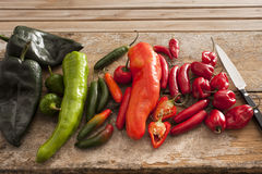Variety of different chili peppers in a kitchen Royalty Free Stock Image