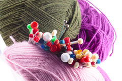 Variety of different knitting needles with wool. Variety of different knitting needles with colorful balls of yarn or wool viewed from the top of the needles in Royalty Free Stock Photography