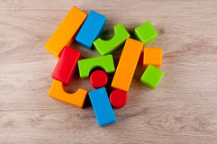 Variety of different plastic toy blocks on table Royalty Free Stock Image