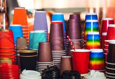 Variety of different size and color takeaway paper coffee cups including clipping path. Selective focus.  Royalty Free Stock Images