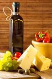 Variety of different vegetables,with glass bottle and cheese Royalty Free Stock Image