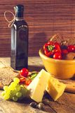 Variety of different vegetables,with glass bottle and cheese Royalty Free Stock Photos