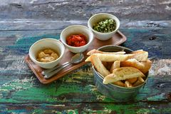 Variety of dips with bread. On old wooden table royalty free stock photos