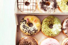 Variety of donuts. Packed in cardboard boxes, ready for delivery, detail royalty free stock photography