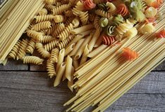 Variety of Dried Pasta Types Ready to be Cooked stock photo