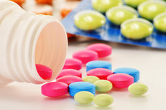 Variety of drug pills and dietary supplements. Composition with variety of drug pills and dietary supplements stock photos