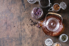 Variety of dry tea with teapot Stock Image