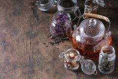 Variety of dry tea with teapot Stock Photography
