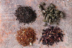 Variety of dry tea with teapot Stock Photos