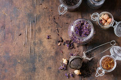 Variety of dry tea with teapot Royalty Free Stock Photography