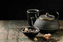 Variety of dry tea with teapot Stock Images