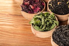 Variety of dry teas. In wooden bowls royalty free stock images