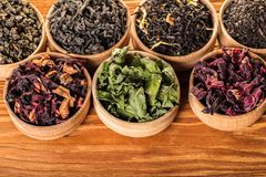 Variety of dry teas. In wooden bowls stock photography