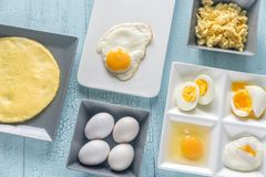 Variety of egg dishes. On the wooden table Stock Images