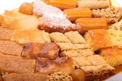 Egyptian desserts. Variety of Egyptian desserts on dish over white background Stock Photography