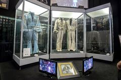 A Variety Of Elvis Presley Stage Uniforms At Graceland. A variety of Elvis Presley stage uniforms, on display at Graceland royalty free stock photo