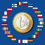 Variety of european flags around one euro coin, close up Stock Image