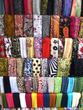 Variety of Fabrics. Many colorful and designer fabrics on display in indian market stock images