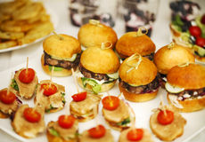 Variety of finger food on catering event. Shallow focus Stock Photos