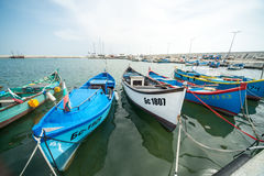 The variety of fishing boats on the new pier Sarafovo in Bourgas, Bulgaria Stock Image