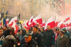 Independence Day March in Warsaw Poland Marred by Violence and Controversy. A variety of flags are waved and armbands worn by protesters at the annual Polish Stock Photos