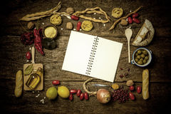 Variety of food ingredients and empty notebook stock images
