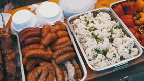 Variety of food lies in the container on the table at the street stock footage