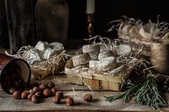 Variety of French Cheeses in a Dusty Pantry. Variety of French Cheeses and Another Provision in a Dusty Pantry royalty free stock image