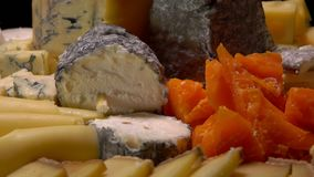 Variety of French cheeses. Parmesan Camembert Etorki Roquefort Mimolette stock video footage