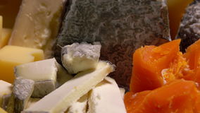 Variety of French cheeses. Parmesan Camembert Etorki Roquefort Mimolette stock video