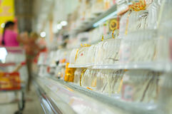 Variety of fresh biscuit caces on shelves Royalty Free Stock Image