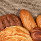 Variety of fresh bread over sackcloth Royalty Free Stock Images