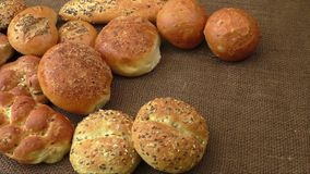 Variety of fresh bread on sacking stock video footage