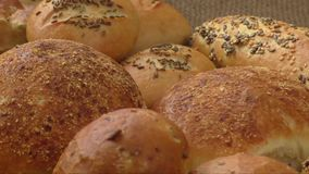 Variety of fresh bread. On sacking stock footage