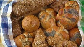 Variety of fresh bread. On sacking stock video