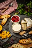 Variety of fresh food ingredients for Sweet berry crostini sandwiches with ricotta mango cranberry, rustic background, top view,. Copy space. vertical image royalty free stock photo