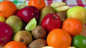 Variety of fresh fruit. Fresh fruit on colored kitchen towel stock footage