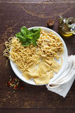 Variety of Fresh Homemade Pasta. On wooden background Royalty Free Stock Photos