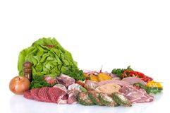 Variety of fresh meat. Garnished with lettuce and parsley, studio shot Royalty Free Stock Image